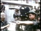 ARVN combat cameraman film American troops as they move into action