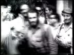 Fidel Castro with his military forces and 26th of July Movement celebrate as they occupy Havana after Batista flees