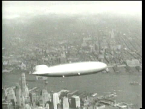 The Hindenburg Zeppelin flies over New York City before it experiences a catastrophic explosion at Lakehurst New Jersey
