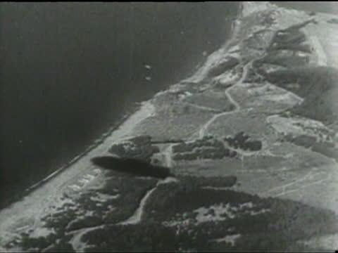 The rigid airship USS Macon crashes near Point Sur California