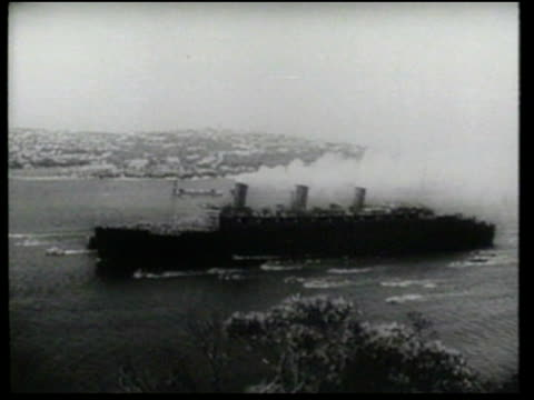 Troops and civilians wave as the world's largest troopship arrives in Australia