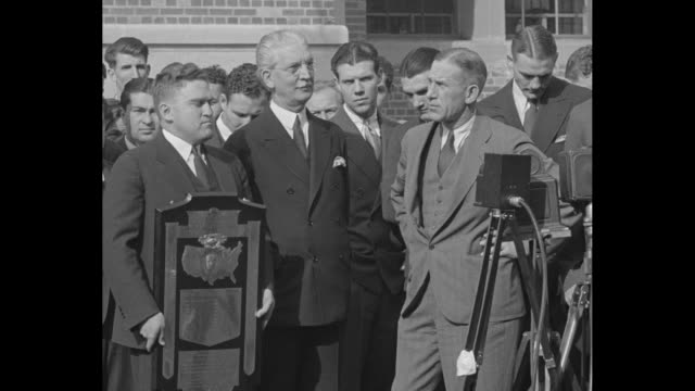 University of Illinois Professor Frank Dickinson inventor of the mathematical 'Dickinson System' to award national football championships holds Knute...