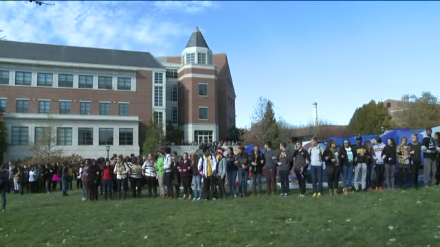 KTVI University of Missouri Campus Protesters Chant Stand Linked ArminArm After Learning System President Tim Wolfe Resigned in Columbia Missouri on...