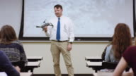 University professor showing a drone in class