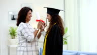 University student celebrating success with her mother, Delhi, India