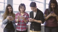 University students texting on their cell phones