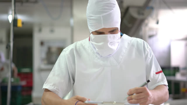 Unrecognizable man working at a dairy factory
