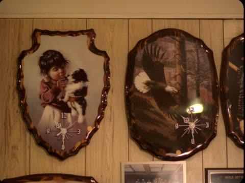 MS, Unusual wall clocks and photography hanging on wall, Reno, Nevada, USA