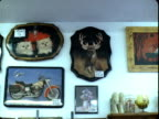 MS, Unusual wall clocks in shop, Tonopah, Nevada, USA