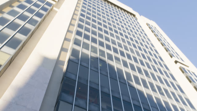 up angle of multi-story office building. adam clayton powell jr state offices. government buildings.