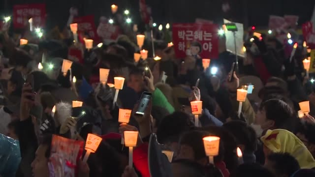 Up to 13 million protesters braved sleet and freezing temperatures in Seoul on Saturday to demand President Park GeunHye resign over a corruption...