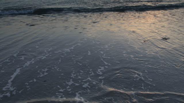 PAN up to sun rising over sea.