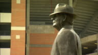 Upper torso profile of Coach Paul W Bear Bryant statue TD/TU Statue w/ stadium BG Iconic college football trademark hounds tooth hat