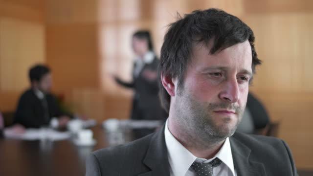 HD DOLLY: Upset Mature Businessman At Meeting