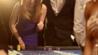 Upward Panning MS of Players Gambling in the Casino