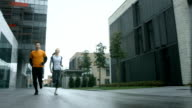 HD SLOW MOTION: Urban Couple Jogging