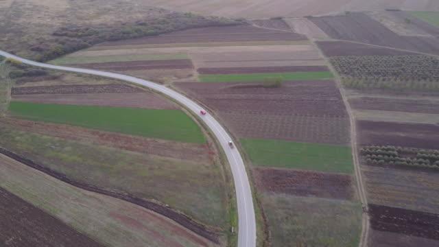 \Urban road through the fields 4k