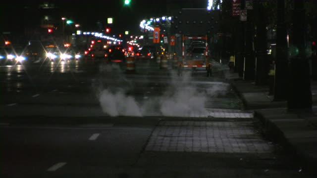 Urban scine. Night city traffic. Ambulance and police cars ahead.
