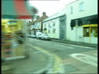 Urban UK Collection T05040707 London Waltham Forest INT CAR **Music overlaid SOT** TRACKING SHOT along past shops and people anonymous woman sitting...