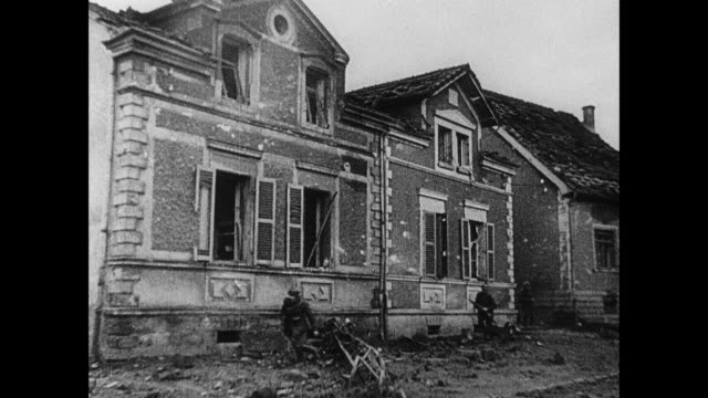 MONTAGE Urban warfare through damaged buildings, soldiers running past damaged houses, ducking through trenches, and manning the Maginot Line / Strasbourg, France