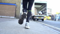 HD SUPER SLOW-MO: Urban Woman Jogging