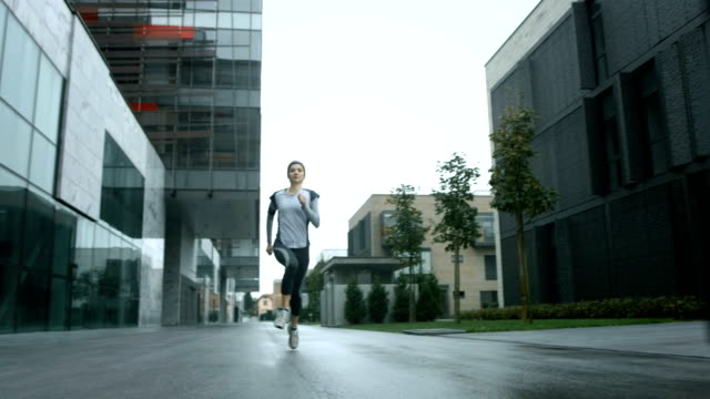 HD SLOW MOTION: Urban Woman Jogging