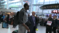 Usain Bolt travels through crowded Heathrow on electric selfbalancing board after arriving from World Championships in Beijing when he was felled by...