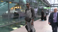 Usain Bolt travels through Heathrow on electric selfbalancing board after arriving from World Championships in Beijing when he was felled by...