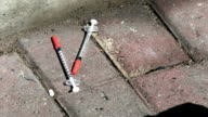 Used syringes on the ground