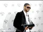 Usher winner of four awards at the 2004 American Music Awards press room at the Shrine Auditorium in Los Angeles California on November 14 2004