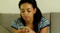 Using digital tablet, at home. Young woman.