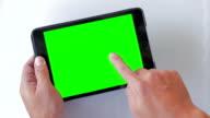 Using digital tablet,Green screen,Close-up