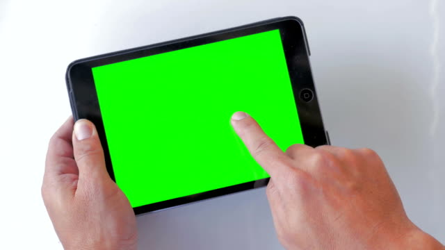 Using digital tablet,Green screen,Close-up