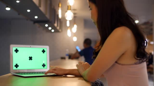 Using Labtop ,Green screen at Counter Bar