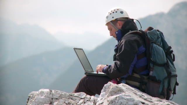 HD: Using Laptop In The Mountains