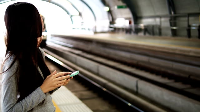 using smart phone while waiting for a train