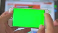 Using smart phone,Green screen