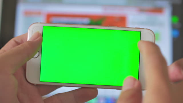 Using smart phone,Green screen
