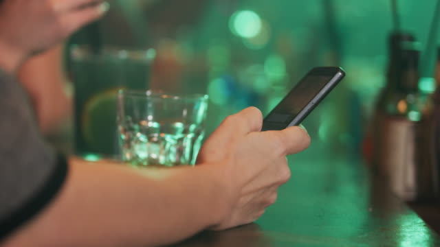 Using Smartphone at The Bar 4K