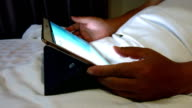 using tablet on bed
