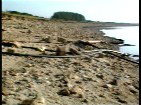 Utilities windfall Tax ENGLAND GV Dried up stoeny banks of reservoir PAN LR pipes leading down into low level reservoir GV Edge of reservoir with low...