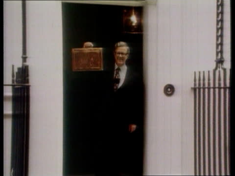 Utilities windfall Tax ITN LIB EXT London MS Sir Geoffrey Howe in doorway holding up Budget Box ZOOM IN ditto
