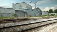 MS Vacant warehouse buildings in small town and  Vermont with railroad tracks / Rutland, Vermont, United States
