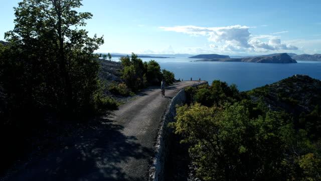 Vacation activities. Riding bike along the coast
