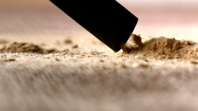 Vacuum cleaner sucking up dust from carpet