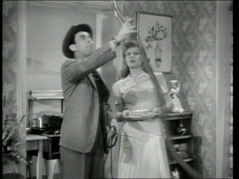 1947 MONTAGE A vacuum salesman visiting a home