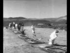 Val Peterson head of the Federal Civil Defense Administration at Nevada Test Site after test explosion to determine effects of abomb blast on...