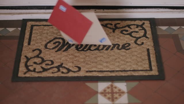 Valentines cards falling on doormat