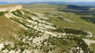 Valley at the foot of white mountains, aerial video