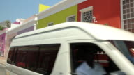 A van drives past brightly coloured houses in the Bo-Kaap area of Cape Town.